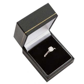 Bespoke solitaire diamond and platinum ring