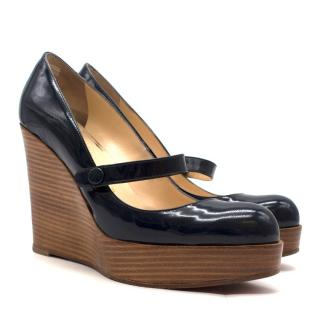 Christian Louboutin Wallis patent leather wedge pumps