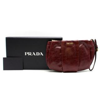 Prada burgundy leather wristlet clutch