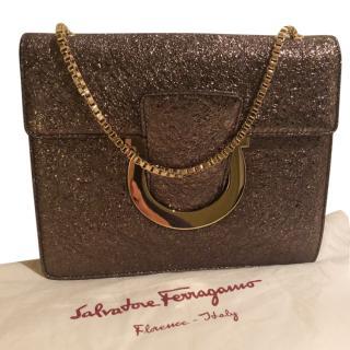 Salvatore Ferragamo gold leather clutch