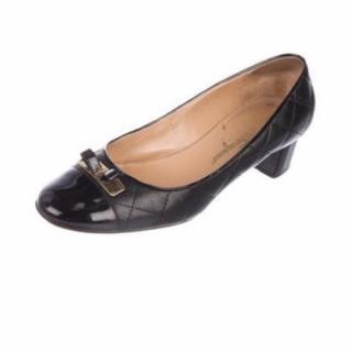 Salvatore Ferragamo black quilted leather patent pumps