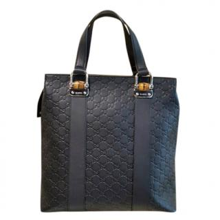 0a9ba950bdc9 Gucci GG embossed black leather tote