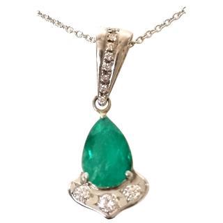 Bespoke emerald and diamond pendant set in 9ct white gold