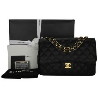 97cd9582fb57 CHANEL Black Caviar Jumbo Single Flap Bag with Gold Hardware