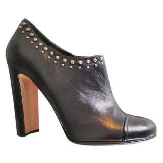Prada stud-trimmed leather ankle boots