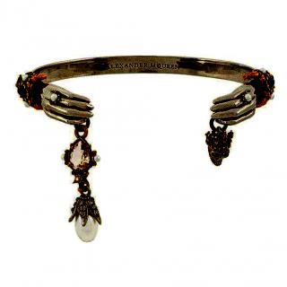 Alexander McQueen skeleton hands bangle with charm