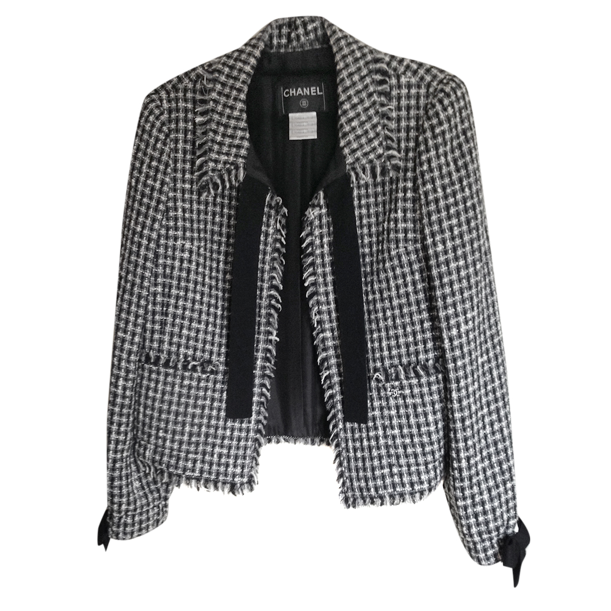 1b190288a Chanel Fantasy Tweed black and white tweed jacket with frayed bows