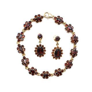 Bespoke Garnet 18 kt gold bracelet and earrings