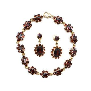 Bespoke Garnet 18 kt gold bracelet and earrings