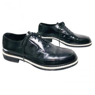 Alexander McQueen black patent leather brogues