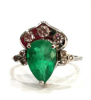 Bespoke pear shaped 2.6 emerald and diamond ring
