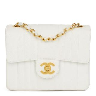 Chanel quilted white caviar leather mini flap bag
