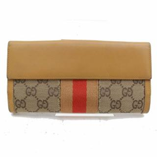 Gucci GG canvas and leather brown wallet