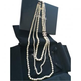 Chanel three strand faux pearl necklace with large crystal CC