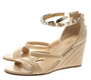 Chanel cream/beige leather charm detail wedge sandals