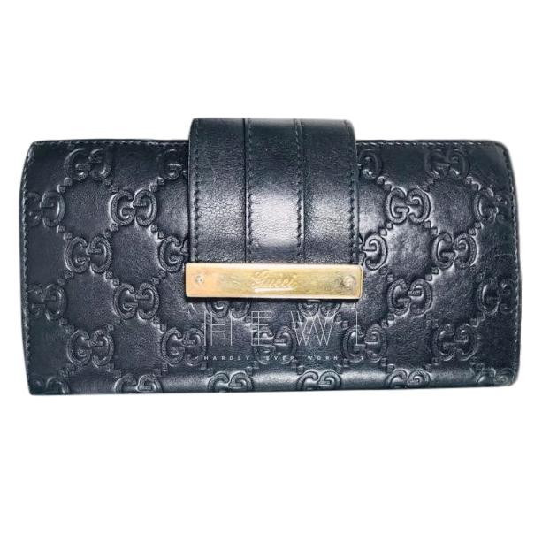 Gucci Monogram Embossed Wallet