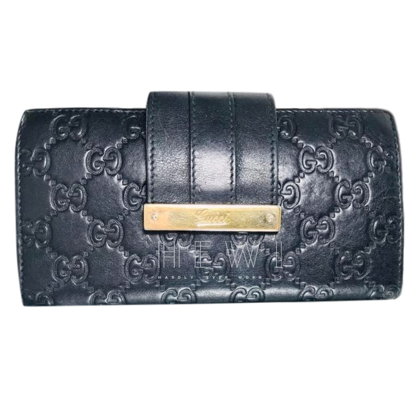 Gucci Monogram Embossed Wallet
