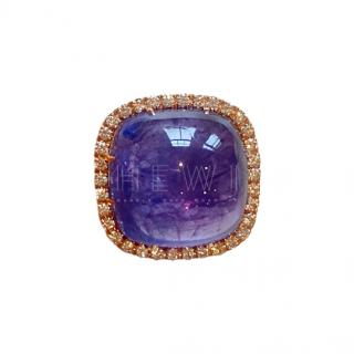 Bespoke large tanzanite surrounded by diamonds cocktail ring