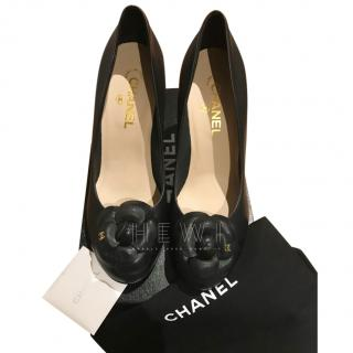 Chanel black leather camellia heeled pumps