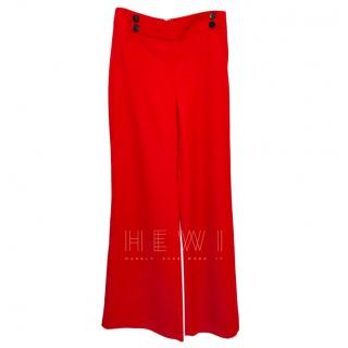 Veronica Beard red flared high-waisted trousers