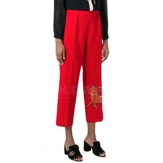 gucci red ankle crop embroidered tiger trousers
