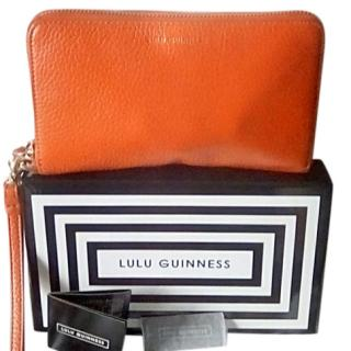 Lulu Guiness orange leather wristlet purse