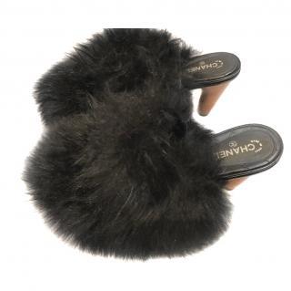 Chanel black sheepskin mules