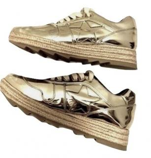 Stella McCartney metallic gold leather trainers