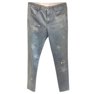 Stella McCartney light blue faded star print distressed jeans