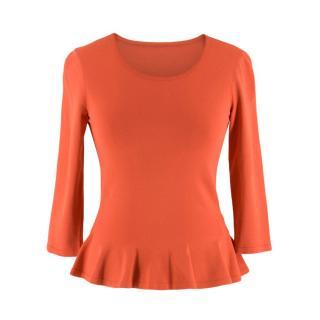 Alaia Coral Peplum Knit Top