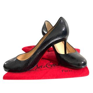 Christina Louboutin black snakeskin pumps