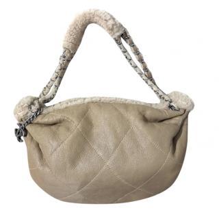 Chanel shearling leather shoulder bag.