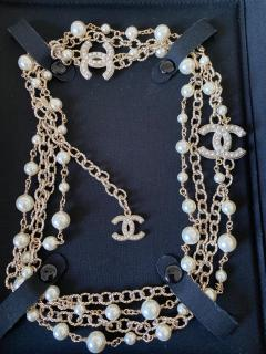 Chanel long faux pearl CC and chain necklace