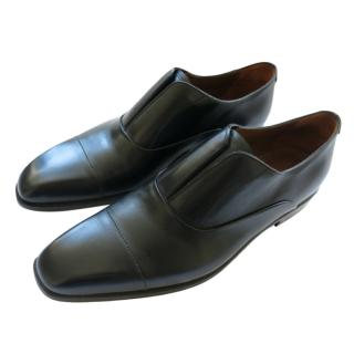 Berluti black leather loafers and trees