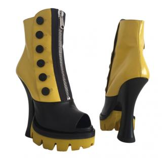Miu Miu runway yellow and black peep toe statement booties