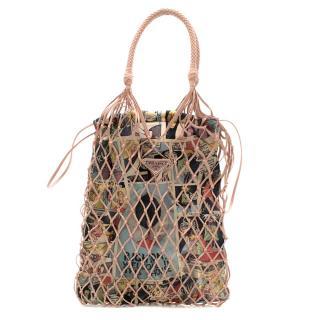 Prada Faux leather mesh and nylon bucket bag with Comic Print Slip Bag