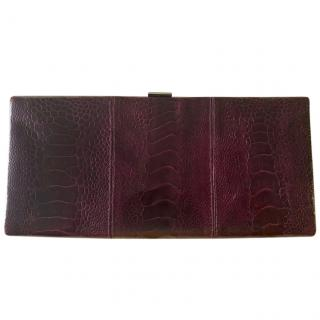 Christian Louboutin croc embossed plum leather clutch bag