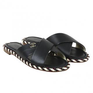 Chanel black leather crossover slides