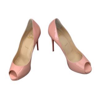 Louboutin pink patent peep toe pumps