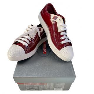 Prada burgundy patent leather trainers