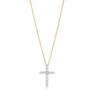 Tiffany & Co. Cross pendant in 18k gold with diamonds