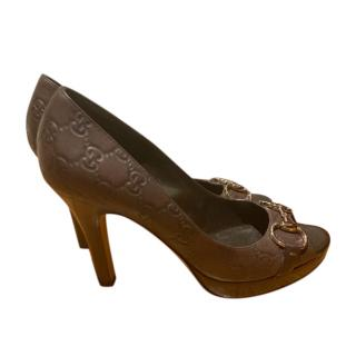 Gucci Embossed Brown Peep-Toe Pumps