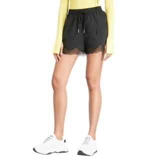 Mo & Co black lace trim shell shorts