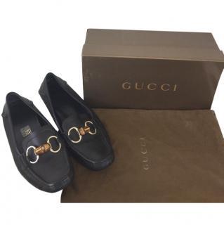 Gucci black flat horse bit loafers