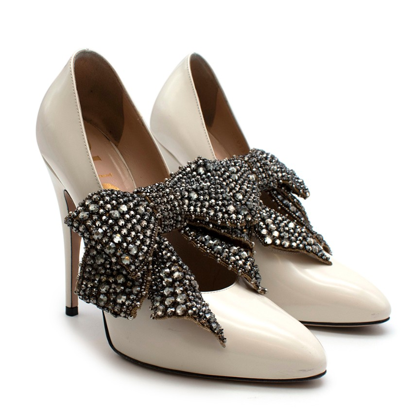 Gucci Ivory Glossed Pumps with Crystal Bow Embellishment