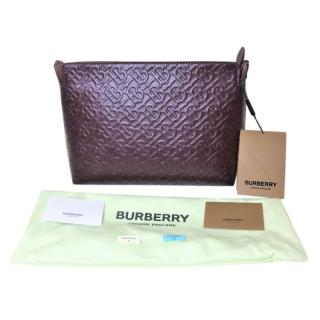 Burberry burgundy leather embossed monogram clutch bag