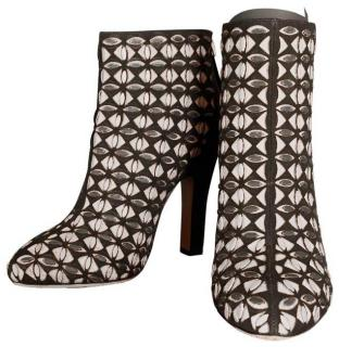 Alaia laser-cut suede and leather ankle boots