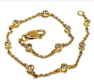 Bespoke white topaz and yelowl gold bracelet