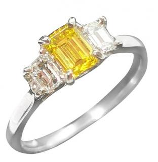 Bespoke emerald cut yellow and white diamond trilogy ring