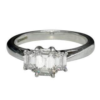 Bespoke emerald cut diamond and platinum trilogy ring
